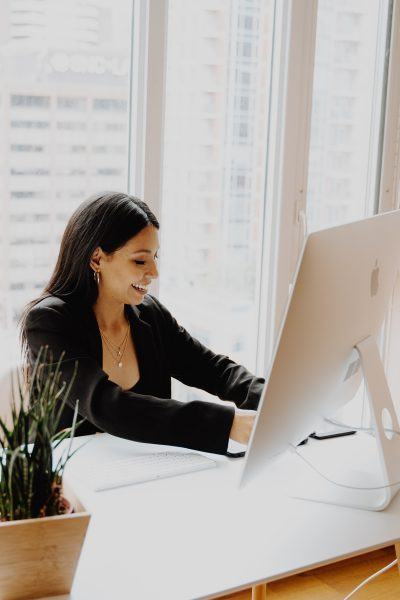 Image of woman at desk - how to get the job you want - A Good Day Careers